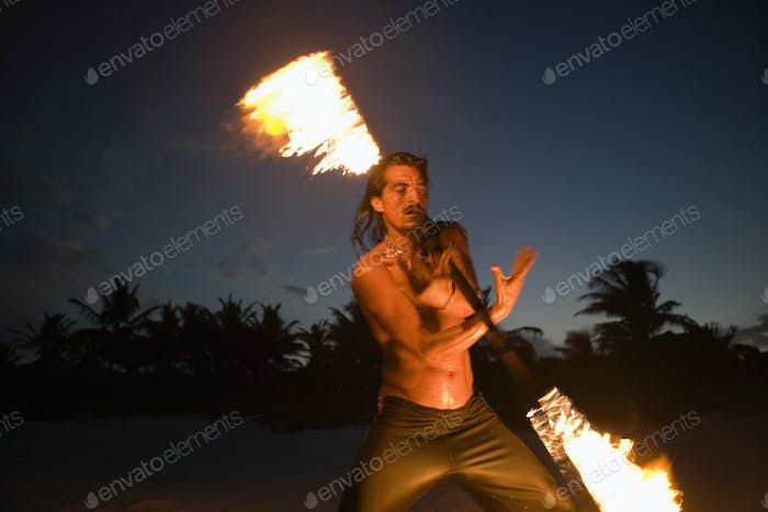 Man spinning a fiery baton