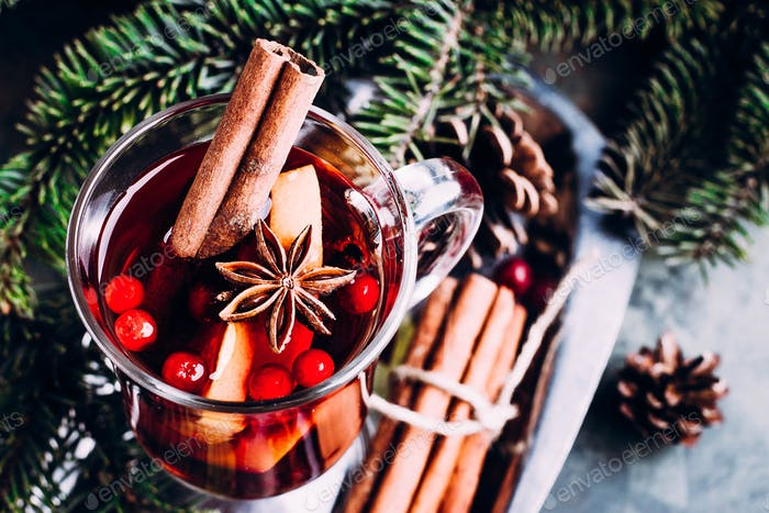 Mulled wine with cinnamon, cowberry, orange and anice. Christmas or New Year drink.