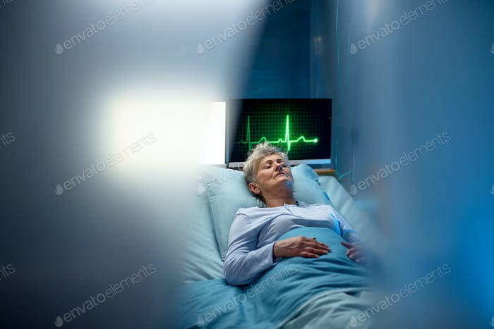 Infected patient in quarantine lying in bed in hospital, coronavirus concept