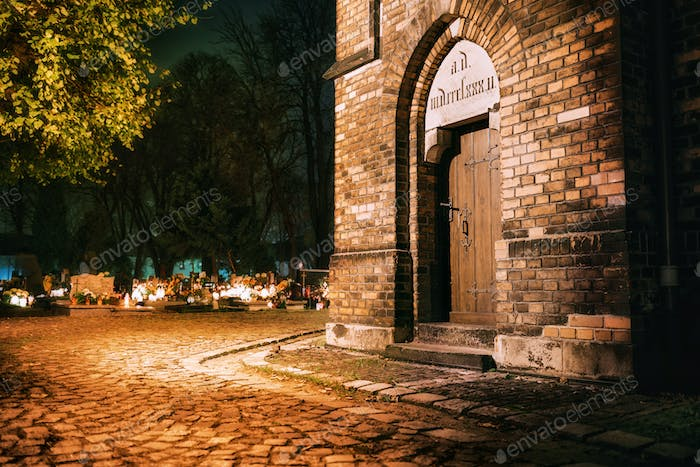 Old church and cemetery at night