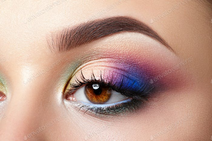 Closeup view of woman eye with evening makeup