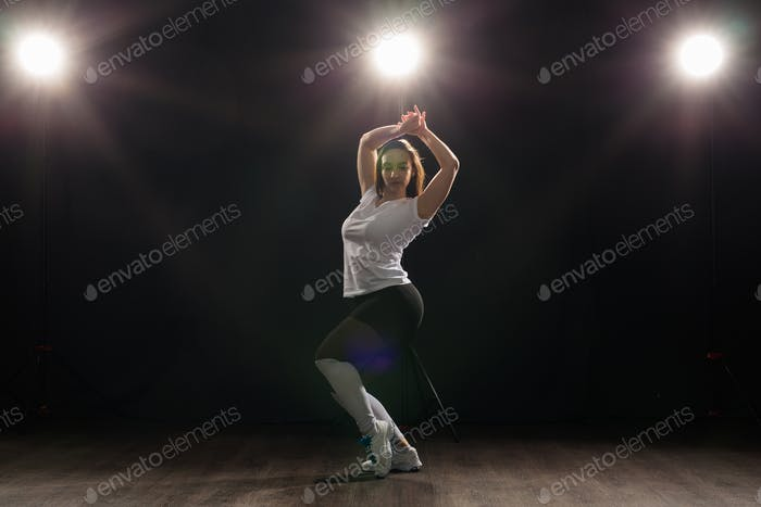 People and dancing concept - Pretty woman dancing jazz funk