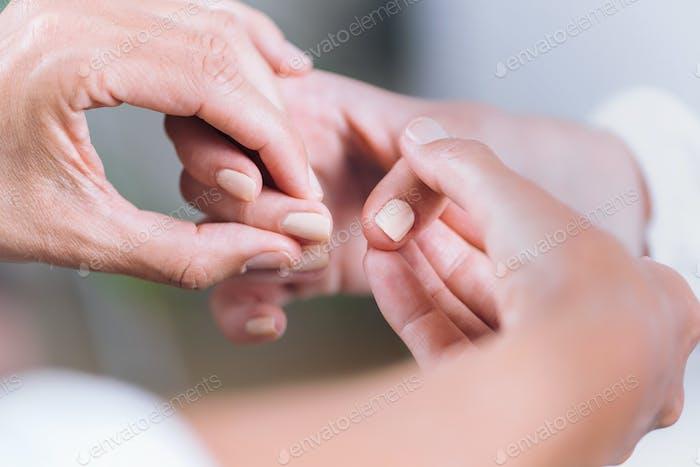 Close-Up Hands At Theta Healing Treatment
