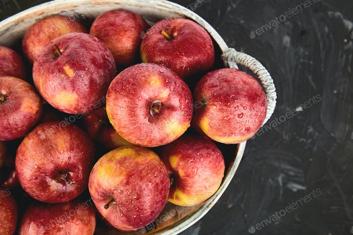 Fresh organic red apples in a basket