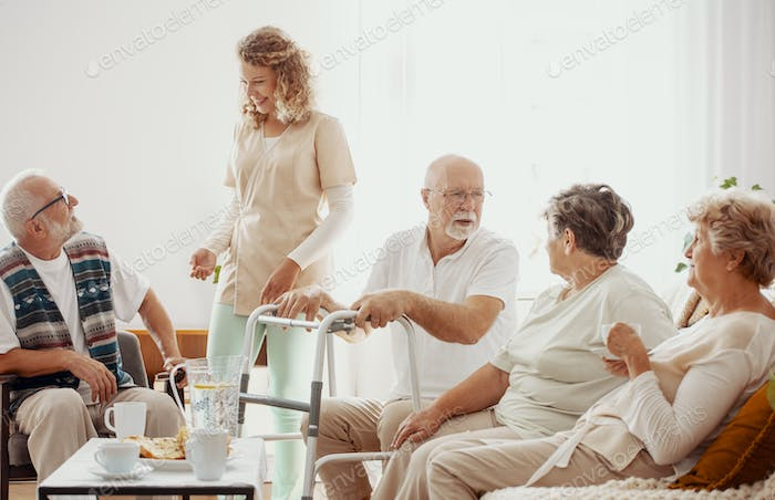 Elders spending time together in the common room of the care hom