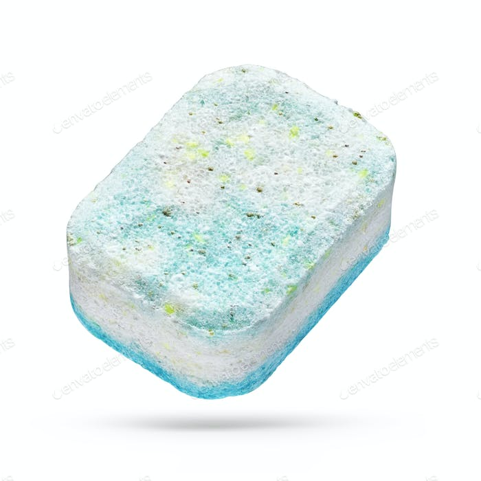 Turquoise dishwasher detergent tablet isolated on white background