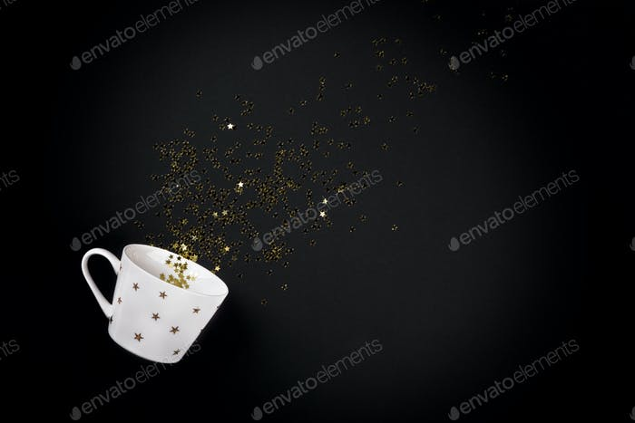 New Year Christmas Top view flat lay cup poured out gold stars confetti
