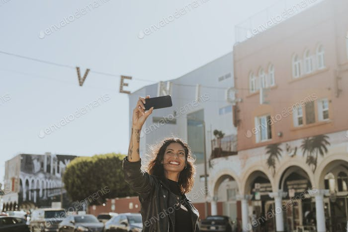 Cheerful woman taking a selfie