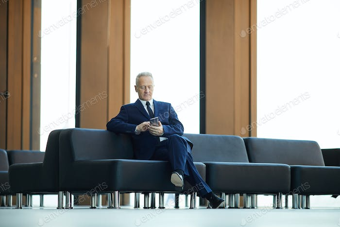 Mature Businessman in Lobby
