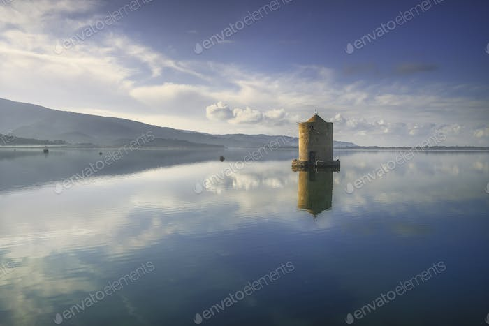Old spanish windmill in Orbetello lagoon, Argentario, Italy.