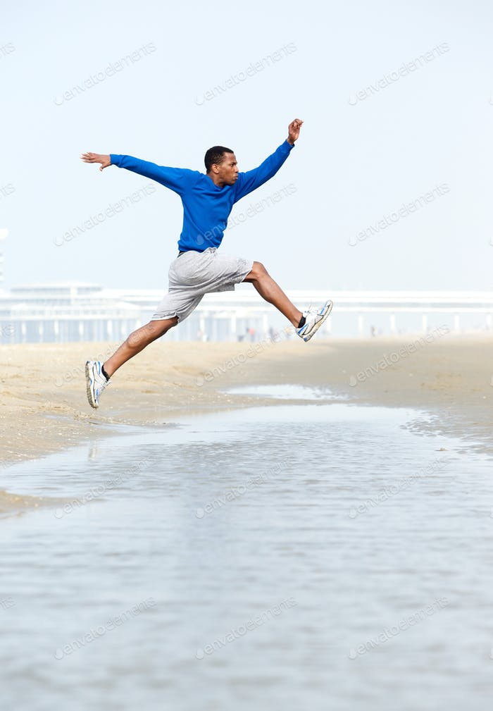 Athletic young man jumping