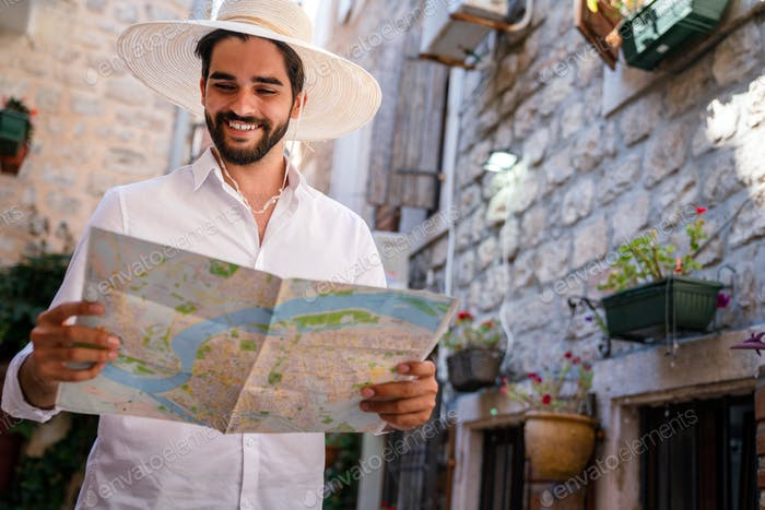Traveler with map. Travel people fun tourism vacation concept