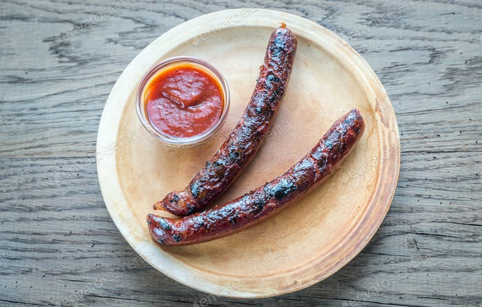 Grilled sausages on the plate