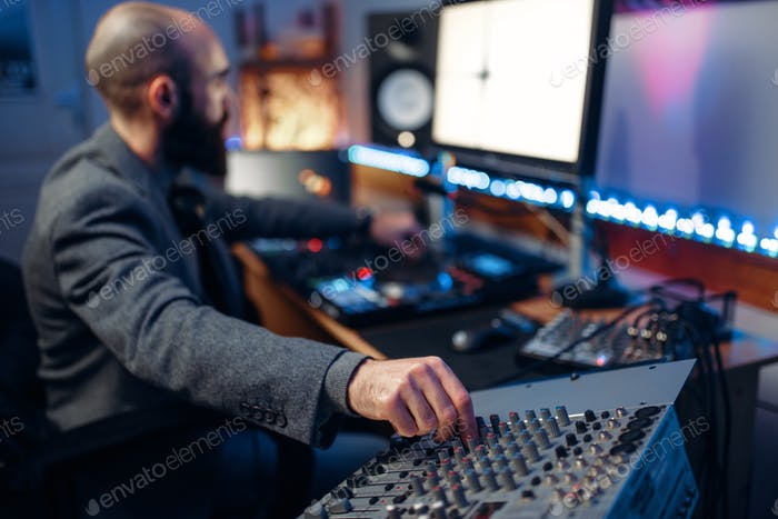 Sound operator in audio recording studio