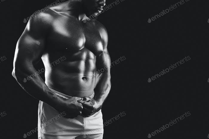Monochrome photo of black fitness model body