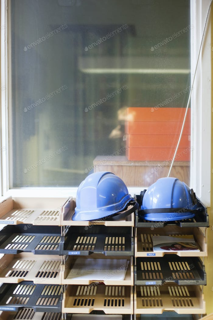 Hardhats on shelves in industry