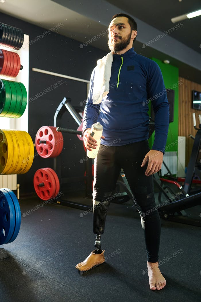 Disabled young man standing in gym