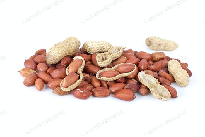 Some whole, shelled roasted peanuts and husk