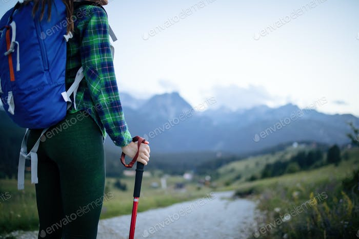 Young woman hikes in the mountain with beautiful view