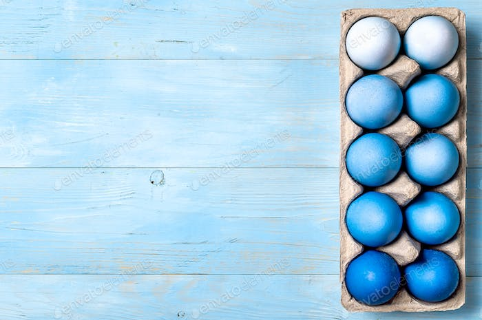 Blue ombre eggs as Easter concept, copy space