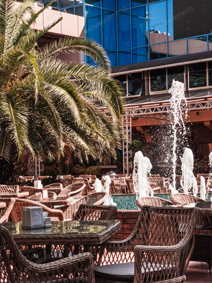 Open air restaurant or cafe interior. Vertical