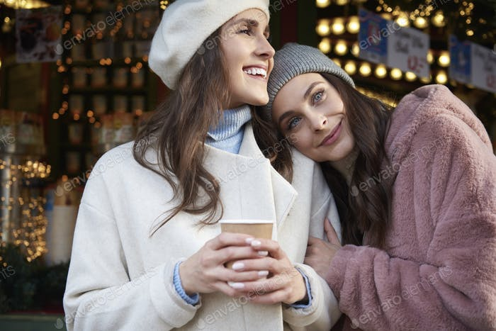Two women hugging on Christmas market