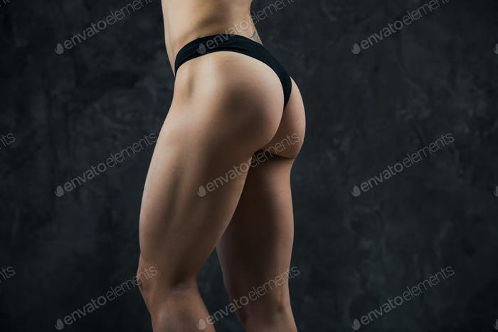 Beautiful athletic ass close-up. Perfect woman sexy buttocks in lingerie. Clean healthy skin. Part