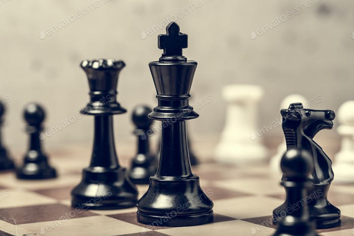 chess pieces on the board in blur selective focus