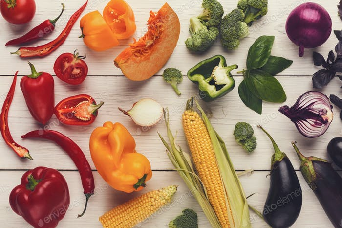 Rainbow background with lots of colorful vegetables