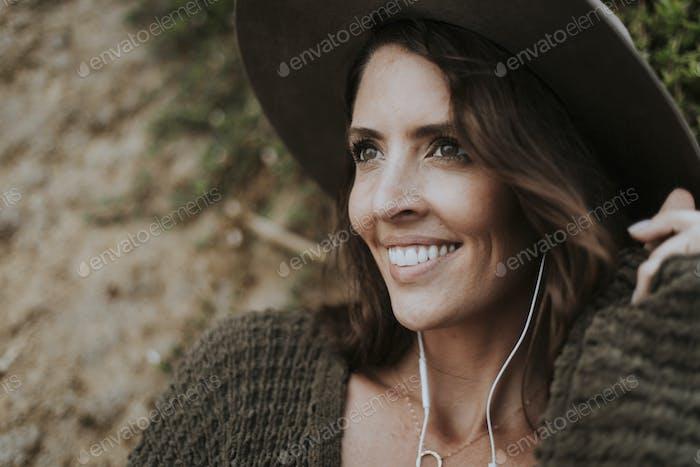 Brunette woman listening to music