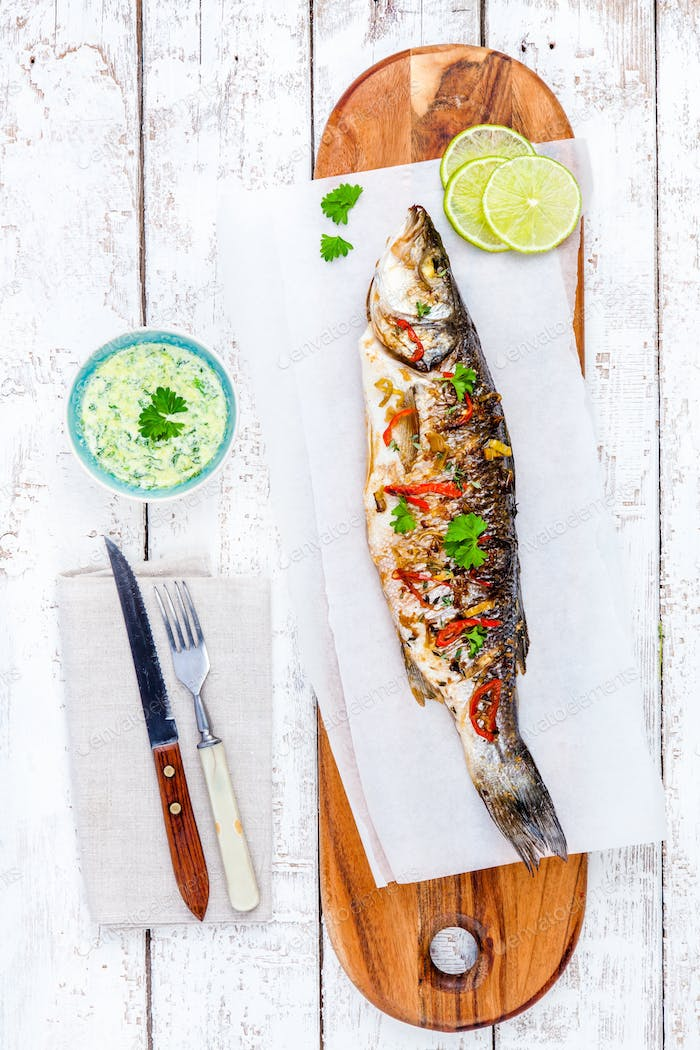 baked fish sea bass with lime and parsley