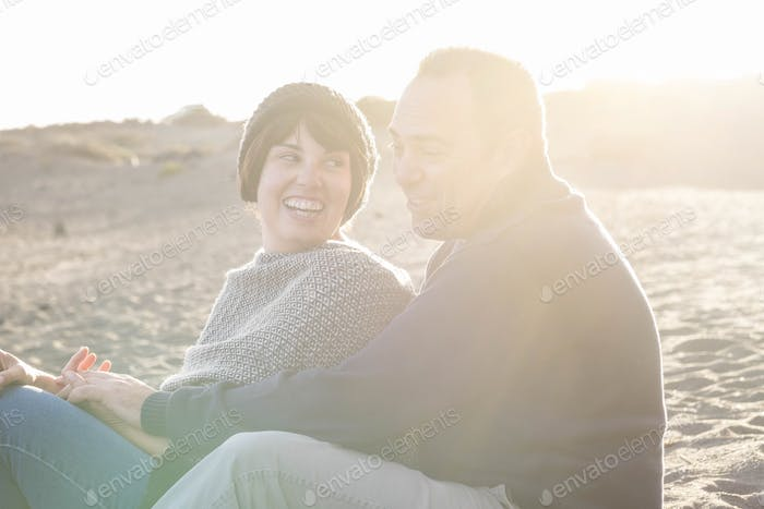 nice beautiful middle age 40 years old couple man and woman caucasian enjoy romantic sunset