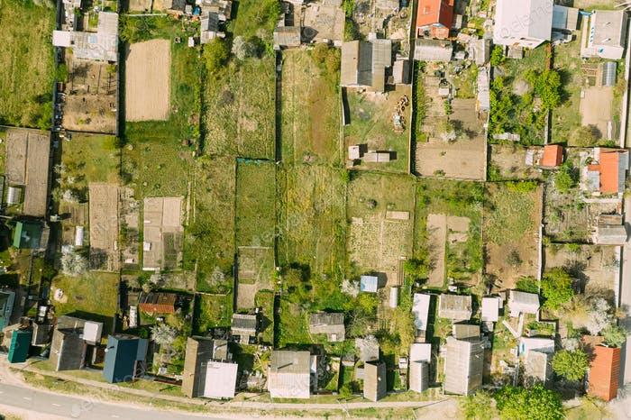 Village Houses And Vegetable Garden Beds In Bird's-eye View.