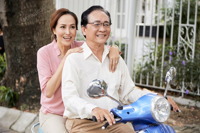 Aged couple on scooter