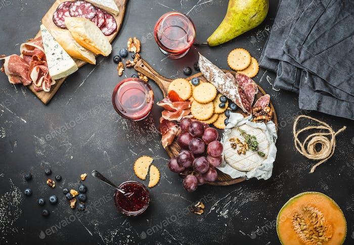 Delicatessen plate and wine