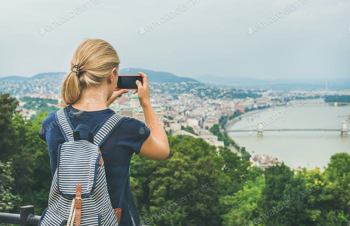 Young woman making photoes of Danube river and Budapest, Hungary