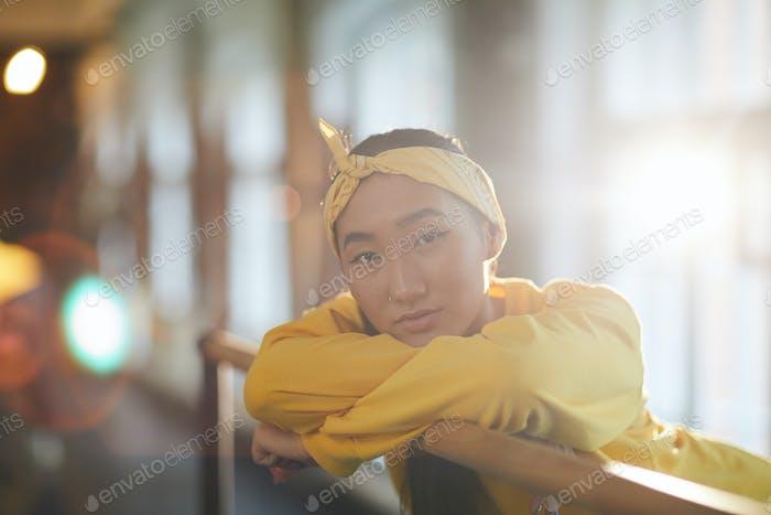 Girl by gymnastic bar