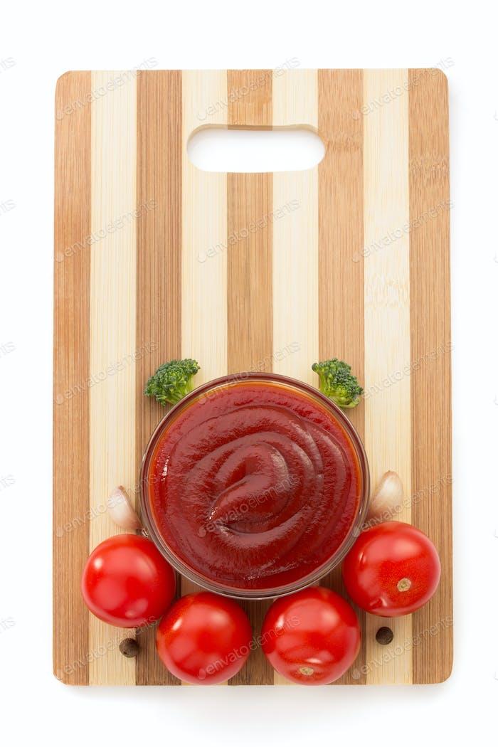 tomato sauce on cutting board
