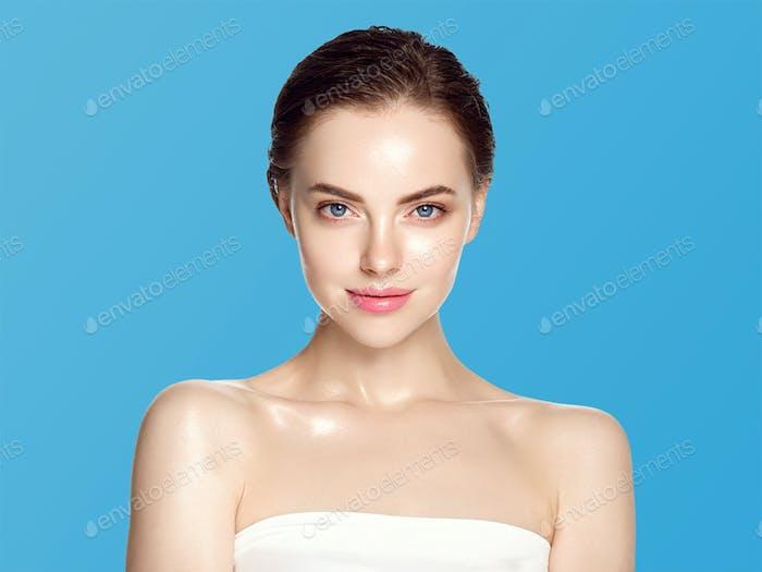 Beautiful woman healthy skin care concept portrait close up blue background. Studio shot.