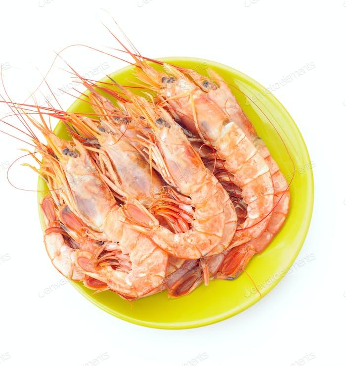 plate of raw prawns on white background