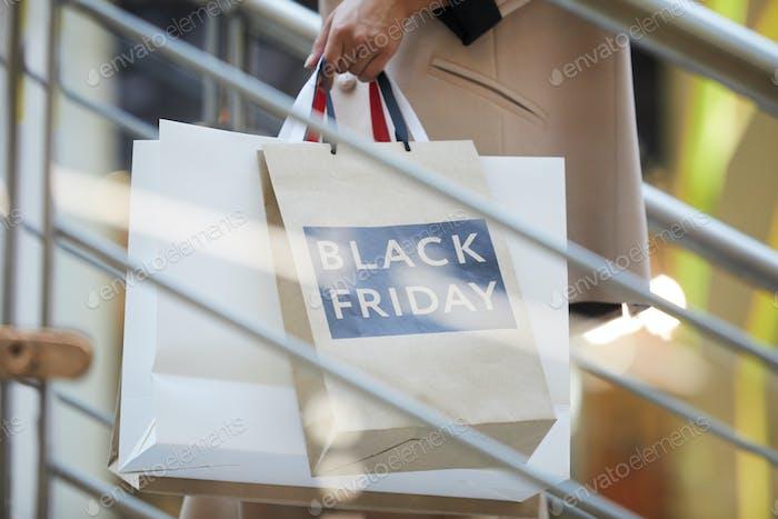 Woman Holding Shopping Bags Closeup