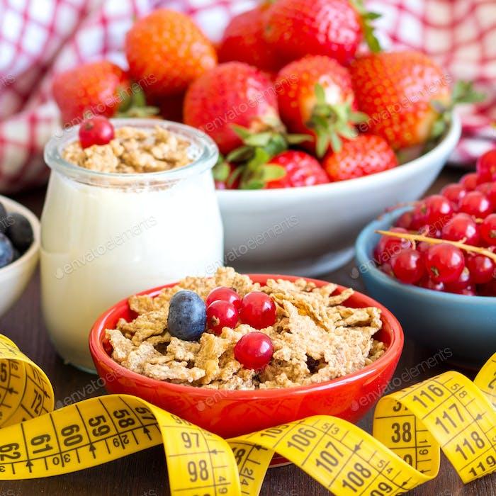 Jars of fresh yogurt, berries, muesli and measuring tape