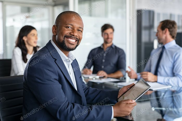 Mature african businessman at meeting