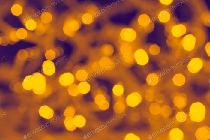 Verschwommene abstrakte Hintergrundbeleuchtung, schöne Weihnachten.