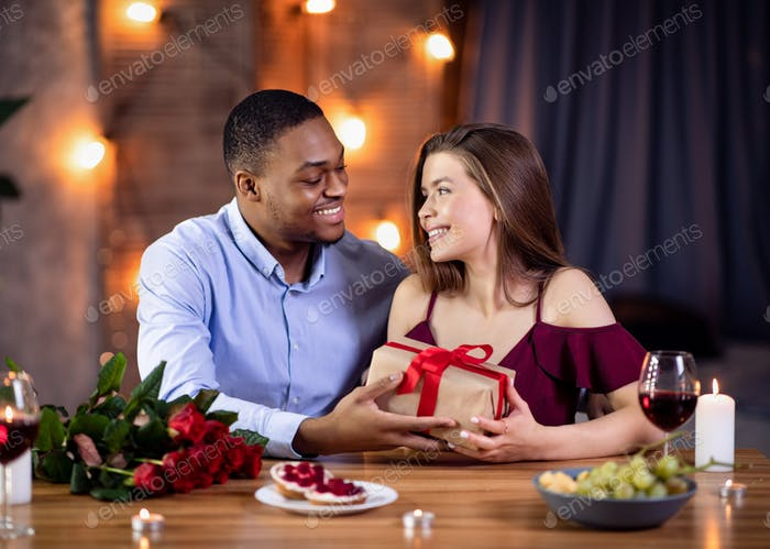 Affectionate African American Guy Surprising His White Girlfriend With Romantic Present