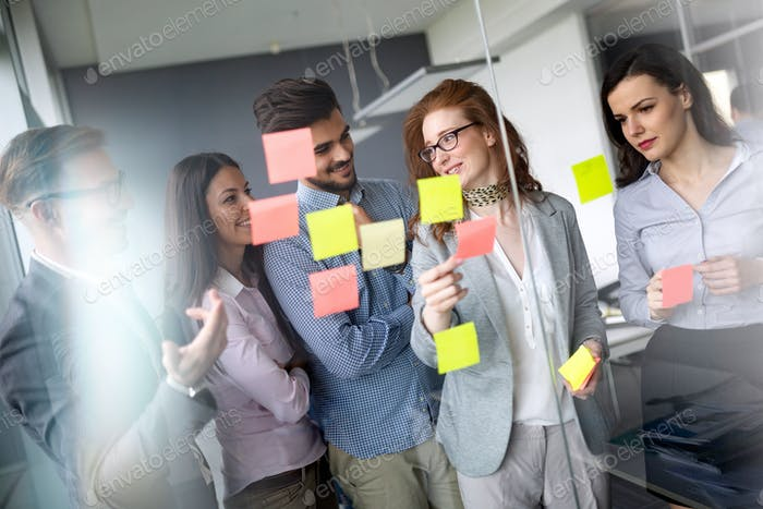 Creative business people working on business project in office