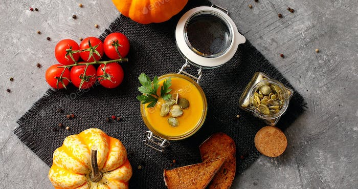 Pumpkin soup with bread and vegetables