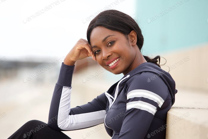 Close up smiling sporty black woman outdoors