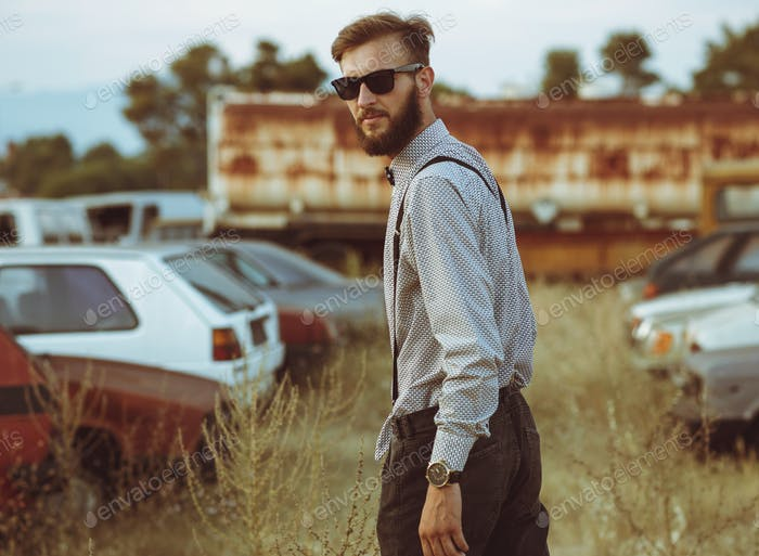 Portrait of a young handsome stylish man, wearing shirt and bow-