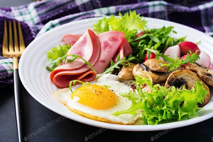 English  breakfast - fried eggs, ham, fried mushrooms, radish and arugula. ketogenic, keto  food.